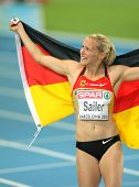 BARCELONA, SPAIN - JULY 29: Verena Sailer of Germany celebrates gold on the Women 100m during the 20th European Athletics Championships at the Olympic Stadium on July 29, 2010 in Barcelona, Spain