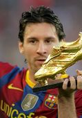 BARCELONA - OCT 3: Leo Messi of FC Barcelona with European Golden Boot award before Spanish league m
