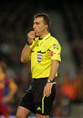 BARCELONA - DEC 12: Referee Fernandez Borbalan blowing whistle during a Spanish League match between