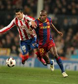 BARCELONA - FEB 5: Reyes(L) of Atletico fight with Abidal(R) of Barcelona during the match between F