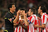 BARCELONA - FEB 5: Atletico Madrid players discuss with the referee Turienzo Alvarez during the matc