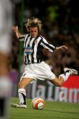 BARCELONA - AUG 24: Federico Balzaretti of Juventus in action during the friendly match between Barcelona and Juventus at Nou Camp Stadium August 24, 2005 in Barcelona, Spain