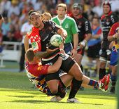 BARCELONA - APRIL 9: Toulons's Loamanu is tackled by Perpignan's player during the European Cup matc