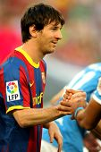 BARCELONA - APRIL 9: Leo Messi of Barcelona shake hands before  the match between FC Barcelona and UD Almeria at the Nou Camp Stadium on April 9, 2011 in Barcelona, Spain