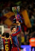 BARCELONA - MAY 15: Gerard Pique of Barcelona celebrates and holds up the trophy league at Nou Camp