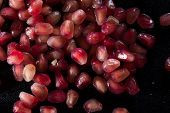 Many Scattered Pomegranate Berries. Background Of Pomegranate Berries. poster
