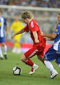 BARCELONA - AUGUST 2: Fernando Torres, Spanish player of Liverpool FC, in action during a friendly match against RCD Espanyol at the Estadi Cornella-El Prat on August 2, 2009 in Barcelona, Spain.