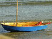 Small Blue Sailing Boat.