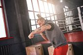 Right Hook. Confident Handsome Athlete In Sports Clothing Boxing With Shadow While Standing Opposite poster