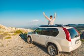 Man Standing Near White Suv Car On The Peak Of The Hill With Beautiful View Of Mountains. Car Travel poster