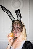 Beautiful Sexy Young Woman With Bunny Ears Holding Easter Egg And Looks Very Sensually. Surprise Wom poster