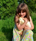 Child Holding Pet Duckling