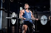 Professional Powerlifter With A Bandage On A Leg, Doing Exercises With A Barbell, Injury Recovery. S poster