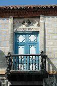 Old Door With Balcony
