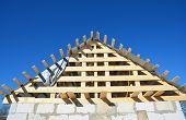 Roofing Construction. Wooden Roof Top Frame House Construction  With Wooden Roof Beams, Trusses, Tim poster