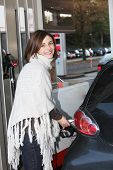 Attractive Woman Filling Her Car With Petrol