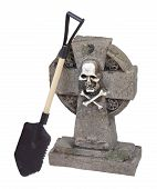 picture of headstones  - Shovel next to a headstone in a cemetery  - JPG