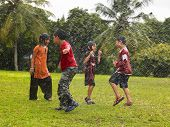 stock photo of wet pants  - Asian kids playing in the park area - JPG