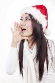 Beautiful woman with santa hat shouting