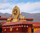stock photo of dharma  - The Rooftop Statues Of Two Golden Deer Flanking A Dharma Wheel In Jokhang Temple - JPG