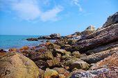 Cliff of seaside under the bule sky