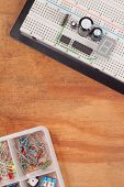 Electrical Circuit On Breadboard On Dirty Wooden Background