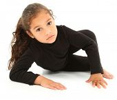 Serious Hispanic Preschooler Crawling on White Floor. Clipping path.