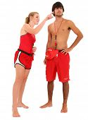 Life guard couple over white with clipping path.