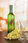 White wine in glass and bottle on room background