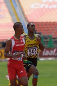 DONETSK, UKRAINE - JULY 12: Jonathan Farinha of Trinidad and Tobago (left) and Odane Bernard of Jamaica compete in 200 m during 8th IAAF World Youth Championships in Donetsk, Ukraine on July 12, 2013