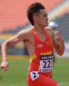 DONETSK, UKRAINE - JULY 12: Youxue Mo of China win the heat in 200 metres during 8th IAAF World Yout