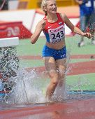 DONETSK, UKRAINE - JULY 12: Kristina Bozic of Croatia competes in 2000 m steeplechase during 8th IAAF World Youth Championships in Donetsk, Ukraine on July 12, 2013