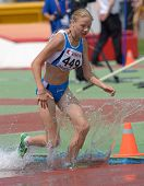 DONETSK, UKRAINE - JULY 12: Nicole Reina of Italy competes in 2000 m steeplechase during 8th IAAF World Youth Championships in Donetsk, Ukraine on July 12, 2013