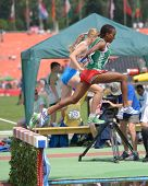 DONETSK, UKRAINE - JULY 12: Weynshet Ansa of Ethiopia (in front) and Nicole Reina of Italy compete i