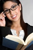 stock photo of pretty girl  - Young beautiful asian business woman reading book - JPG