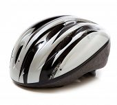 A gray and black bicycle helmet on a white background