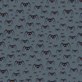 Halloween seamless pattern with spiders.