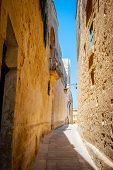 Typical Tight Street In Mdina, Malta, With High Stone Walls Of H