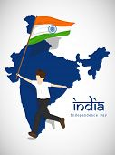 Young boy holding Indian National Flag infront of Republic of India map on abstract grey background.