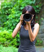 Asian woman taking photo
