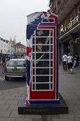 WINDSOR, UK - JULY 21: Prince Harry of Wales depicted on Timmy Mallet's Ring a Royal Post Box. Art installation celebrating all things British, on July 21, 2013 in Windsor, UK.