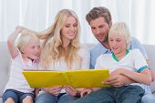 pic of short-story  - Family reading a story together sitting on the couch - JPG