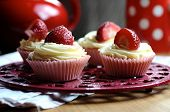 Strawberry And Vanilla Cupcakes In Kitchen