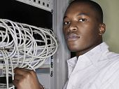 Portrait of network engineer working in server room