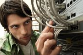 Closeup of network engineer working in server room