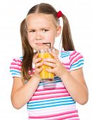 Little girl unwillingly drinking orange juice using straw, isolated over white