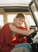stock photo of campervan  - Portrait of happy young woman sitting at driver - JPG