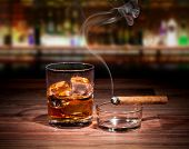 stock photo of cigar  - Whiskey drink with smoking cigar - JPG