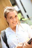 Teenage girl using smarphone at school