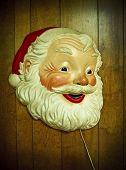 Vintage Santa Claus hanging on wood paneled wall